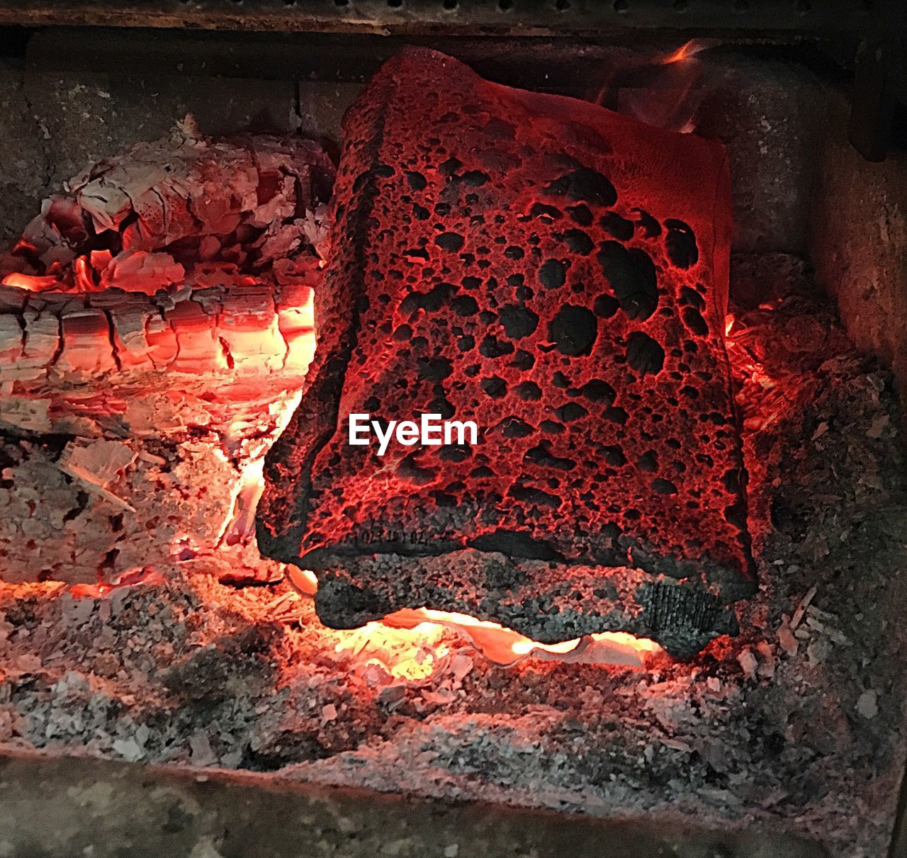 Close-Up Of Heating Wood