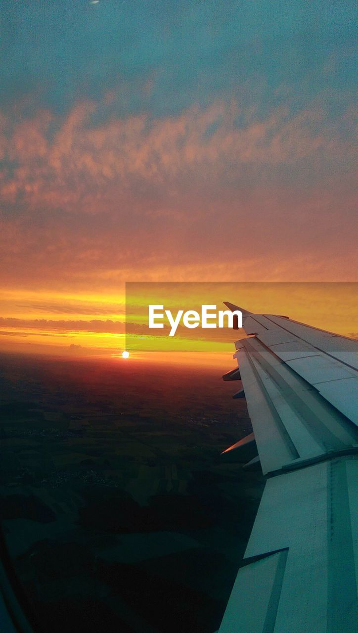 air vehicle, airplane, sky, aircraft wing, sunset, mode of transportation, cloud - sky, transportation, flying, travel, no people, scenics - nature, beauty in nature, orange color, mid-air, nature, journey, outdoors, on the move, window, aerospace industry