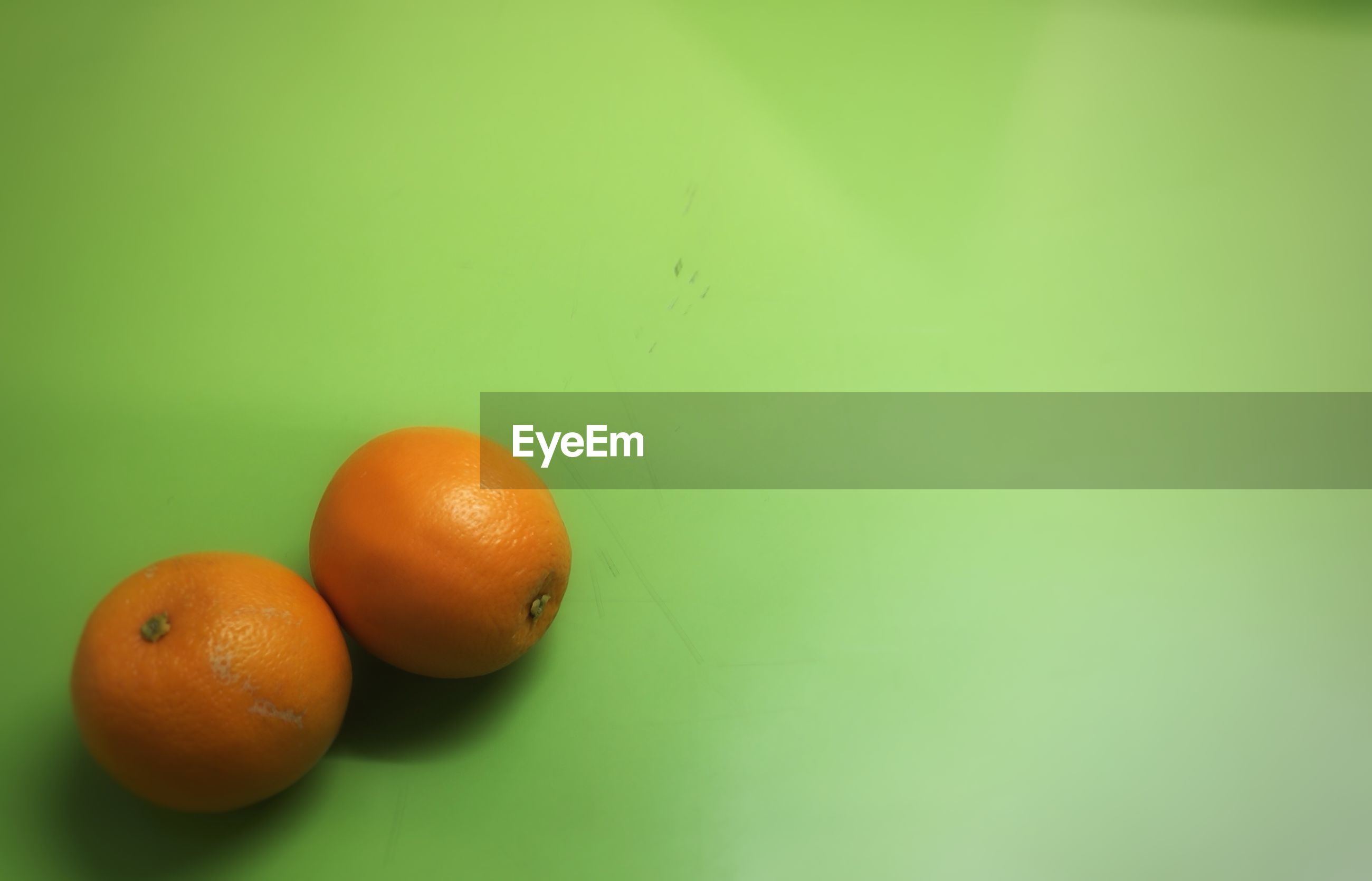 Two tangerines on green