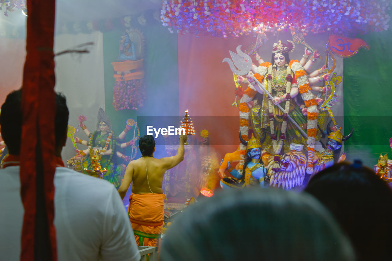 religion, spirituality, belief, architecture, place of worship, art and craft, built structure, human representation, creativity, real people, statue, representation, sculpture, selective focus, group of people, building, men