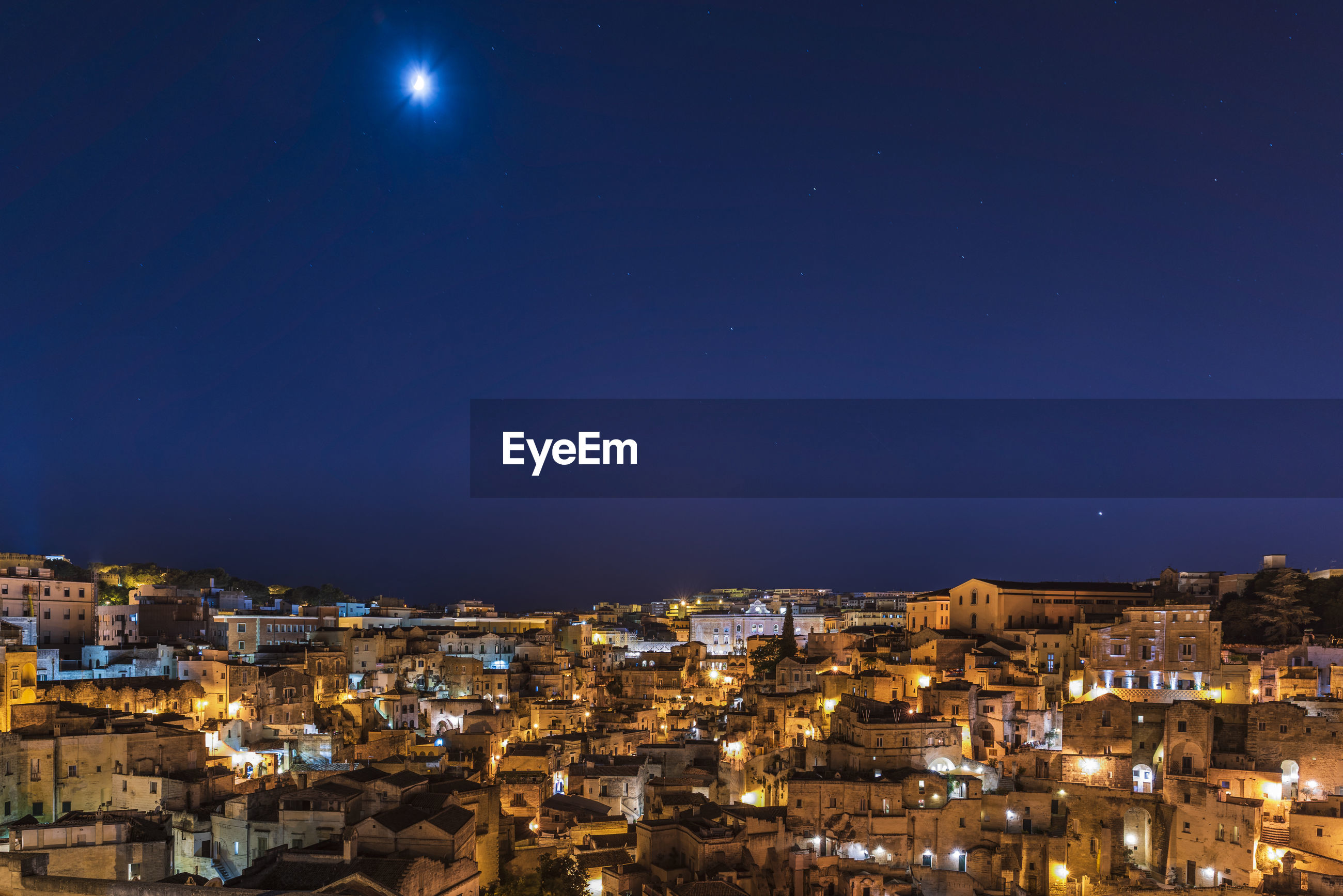 HIGH ANGLE VIEW OF ILLUMINATED TOWNSCAPE AGAINST CLEAR SKY