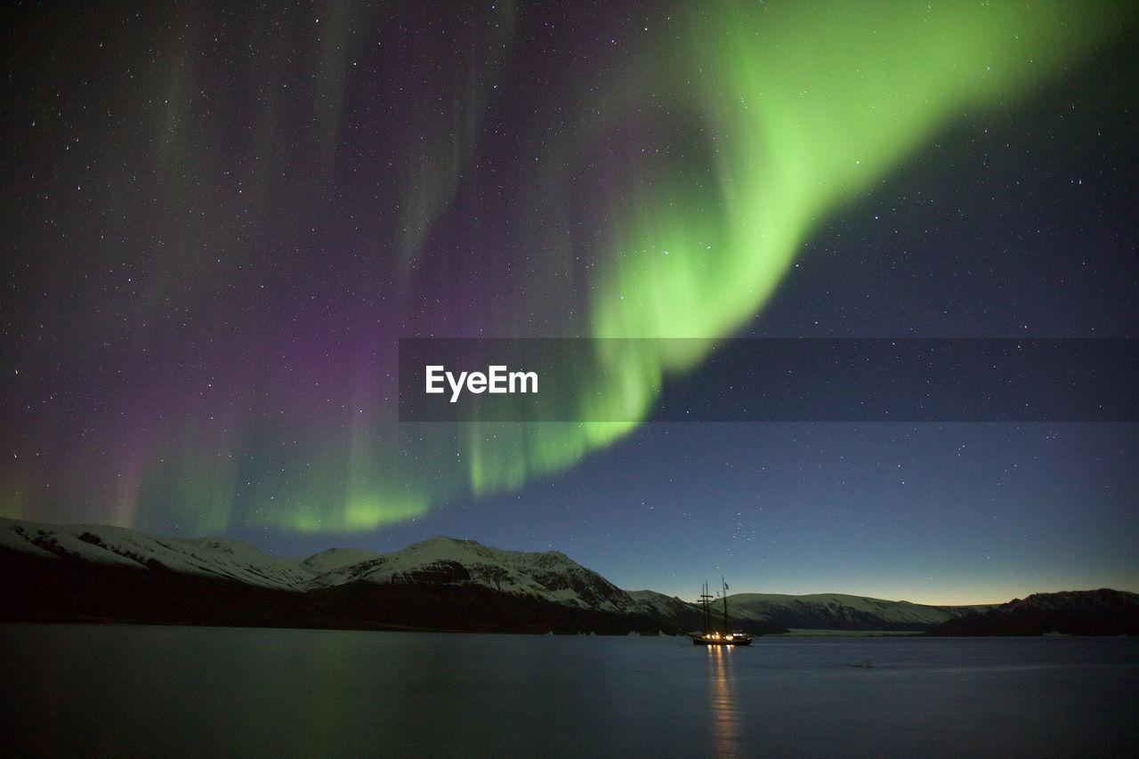 Scenic View Of Lake Against Sky During Aurora Borealis