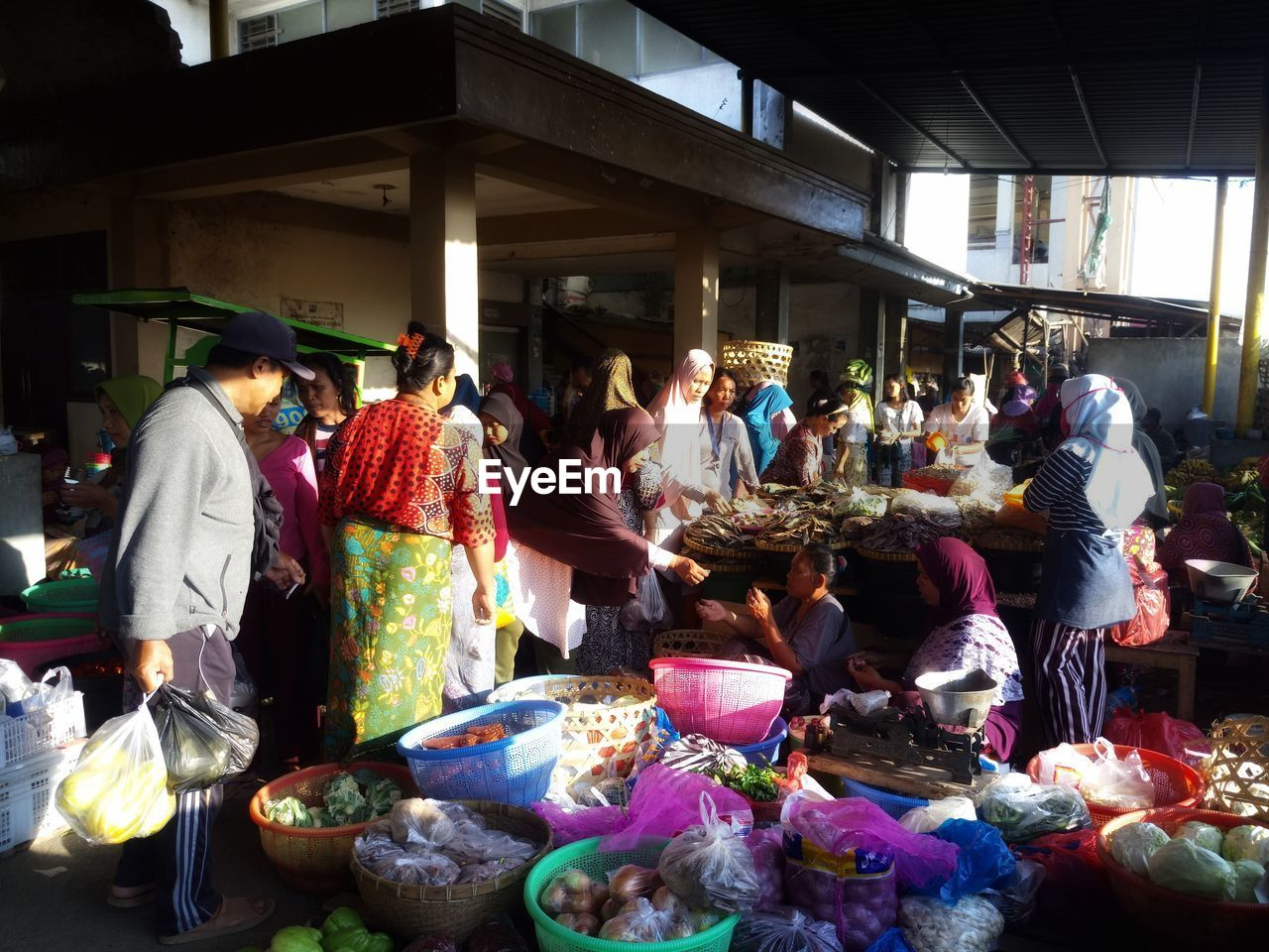 group of people, market, real people, men, for sale, retail, selling, women, large group of people, choice, small business, market stall, business, crowd, day, adult, retail display, variation, large group of objects, sale, buying, street market, consumerism