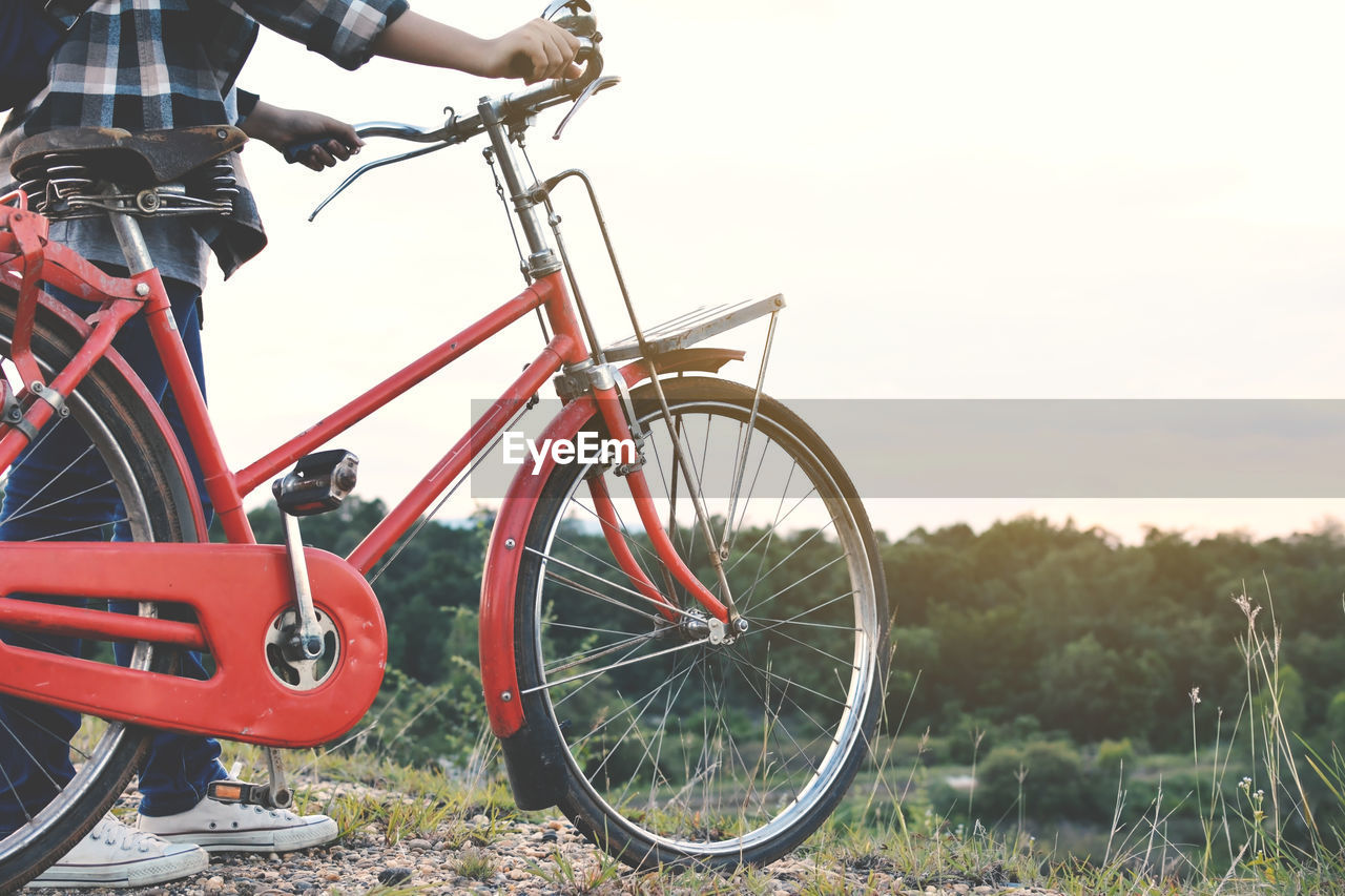 Young Person With Bicycle Outdoors