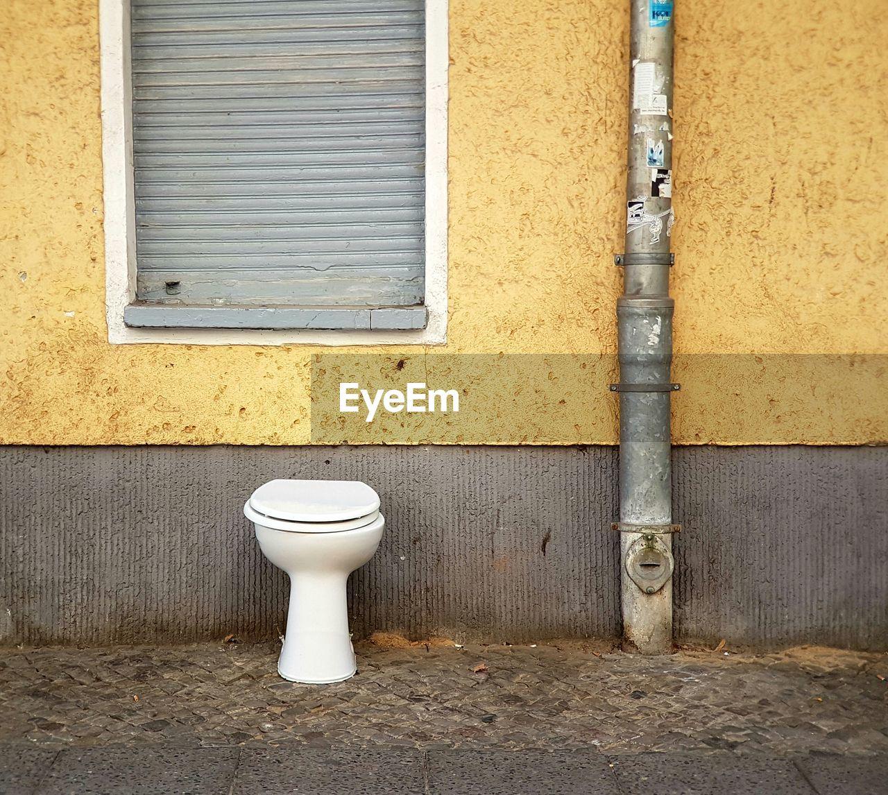 Toilet bowl against building