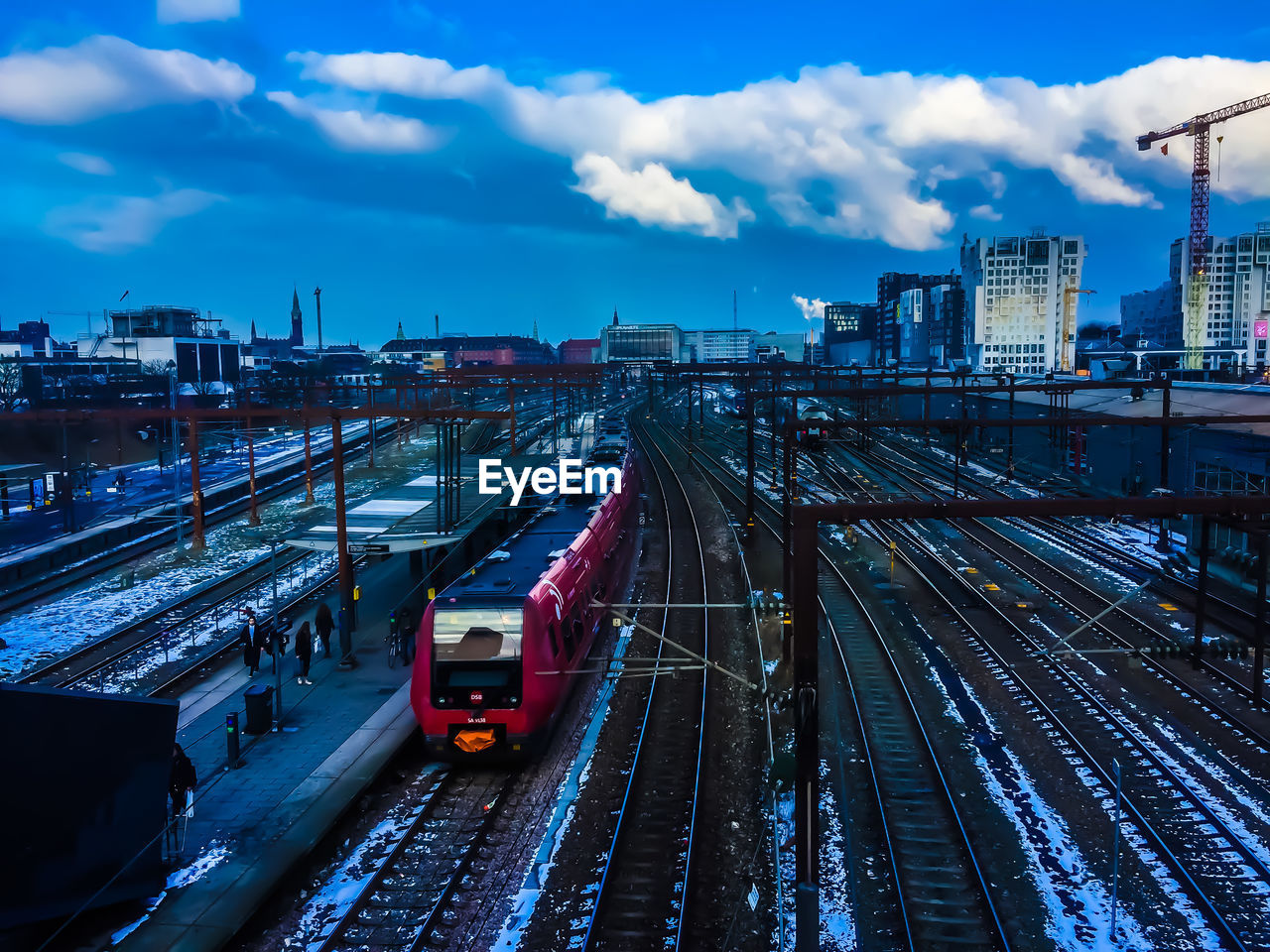 High angle view of railroad tracks in city against sky during dusk