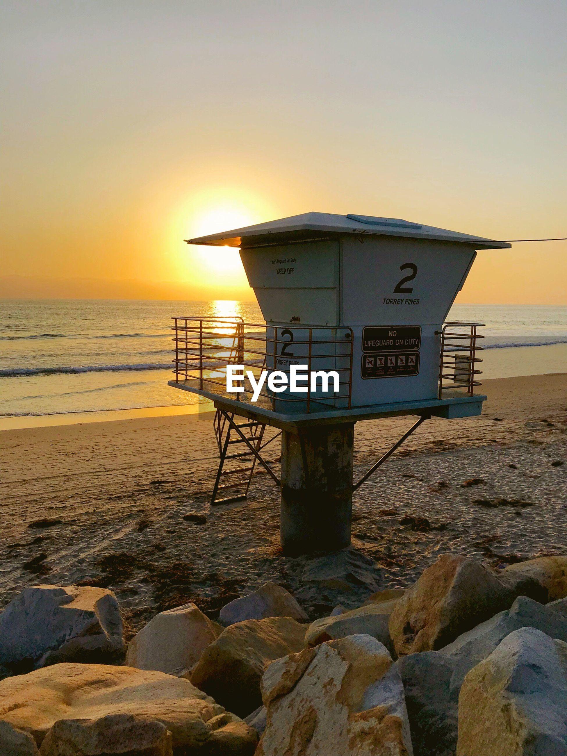 LIFEGUARD HUT AT BEACH AGAINST CLEAR SKY