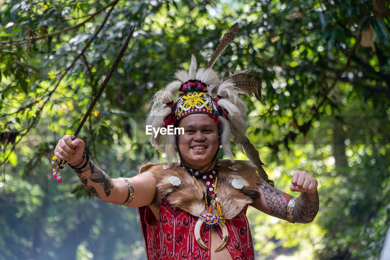 The action of a borneo dayak warrior