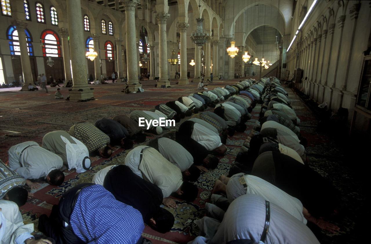 Men offering prayers at mosque