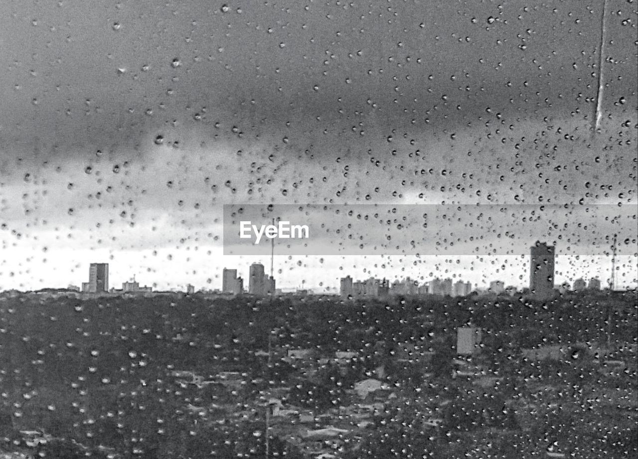 drop, weather, rain, wet, raindrop, skyscraper, tower, city, rainy season, water, cityscape, architecture, building exterior, window, urban skyline, no people, condensation, storm cloud, sky, day, outdoors, close-up