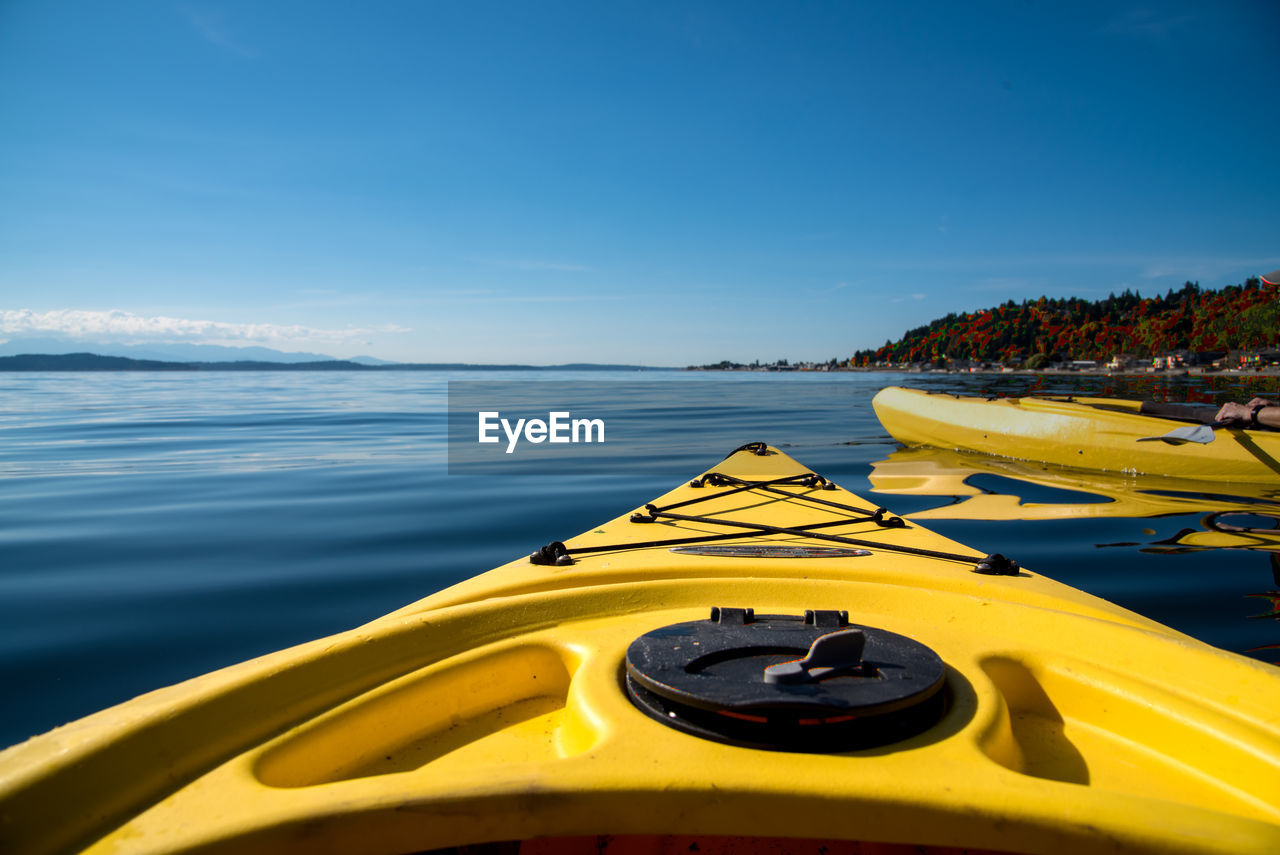 Close-up of kayak over blue water