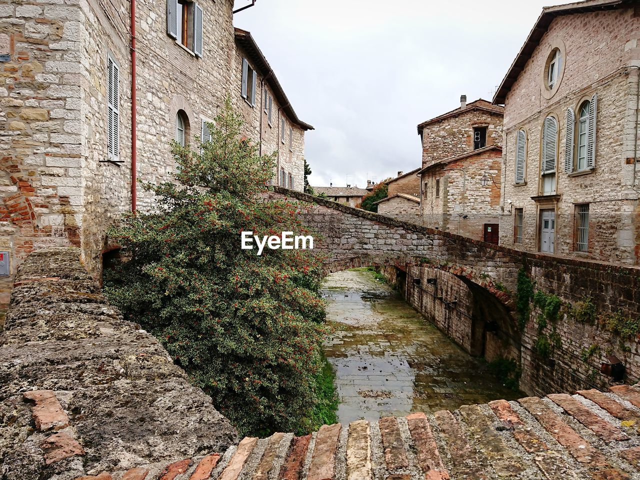 architecture, built structure, building exterior, building, water, wall, day, nature, canal, no people, sky, window, residential district, plant, wall - building feature, outdoors, old, house, brick, stone wall
