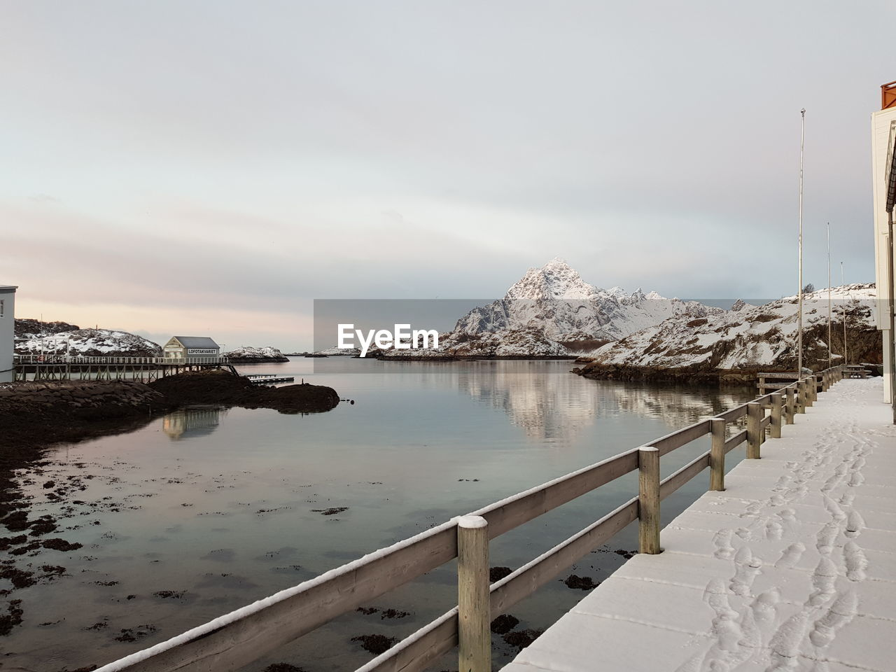 water, sky, nature, scenics - nature, railing, no people, cold temperature, tranquil scene, winter, snow, tranquility, sea, beauty in nature, architecture, day, built structure, cloud - sky, reflection, outdoors