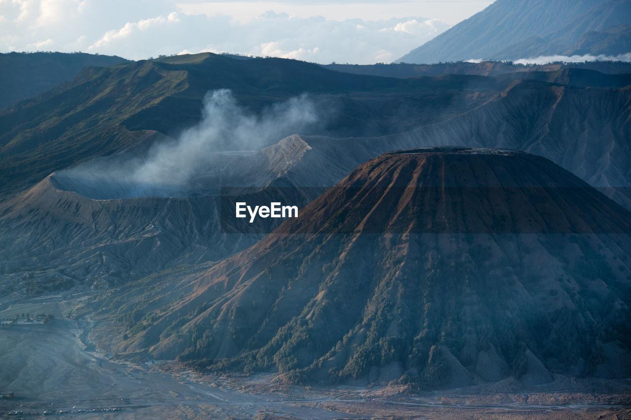 Smoke emitting from volcanic mountain in mount bromo indonesia