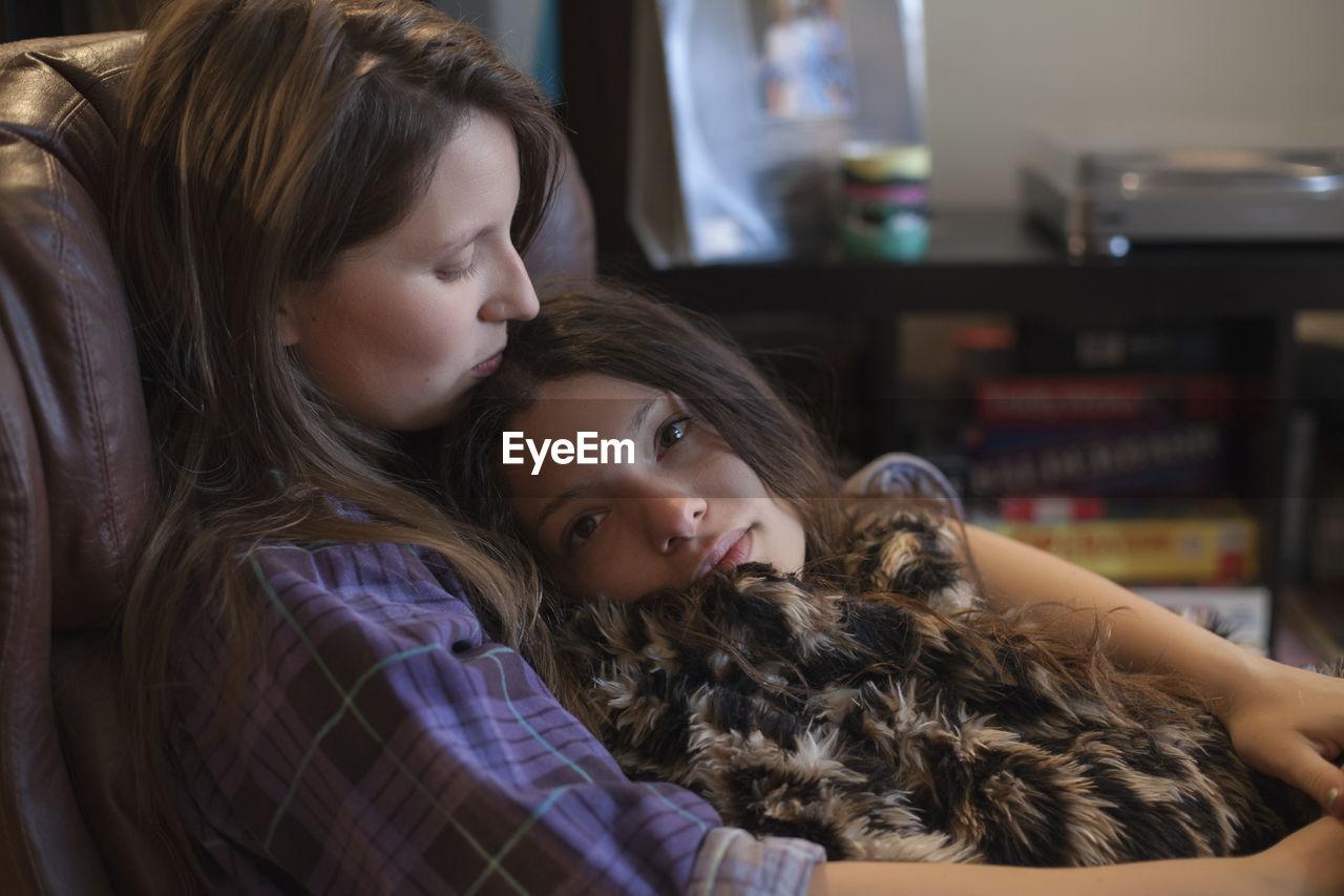Young lesbian couple cuddling