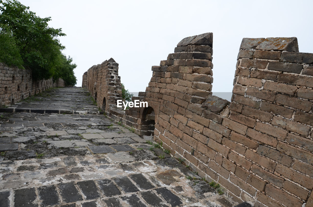 architecture, history, the past, built structure, ancient, sky, wall, no people, clear sky, travel destinations, ancient civilization, old, old ruin, nature, day, tourism, solid, building exterior, travel, wall - building feature, stone wall, stone material, outdoors, ruined, deterioration, archaeology