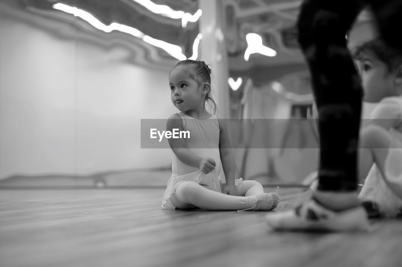Cute Ballerinas With Instructor At Dance Studio
