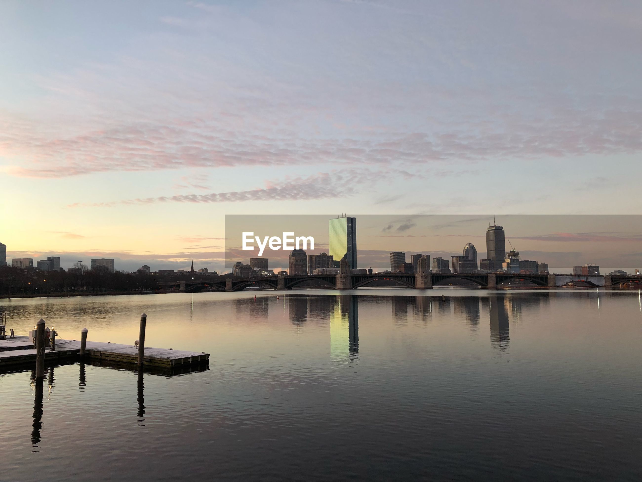 architecture, built structure, sunset, building exterior, water, sky, skyscraper, city, no people, outdoors, modern, nature, urban skyline, cityscape, day