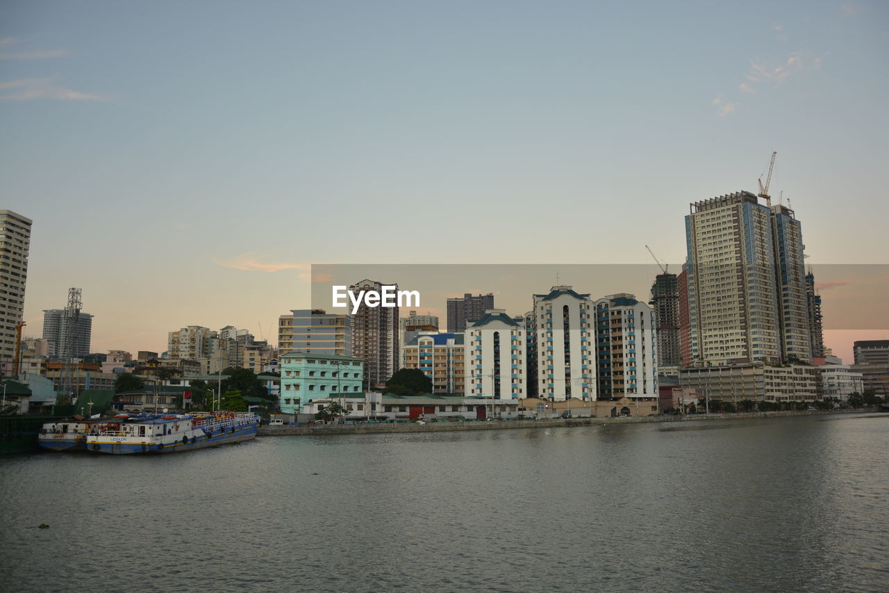building exterior, architecture, built structure, city, building, water, sky, waterfront, office building exterior, skyscraper, urban skyline, landscape, tall - high, cityscape, no people, nature, residential district, river, office, modern, outdoors, financial district