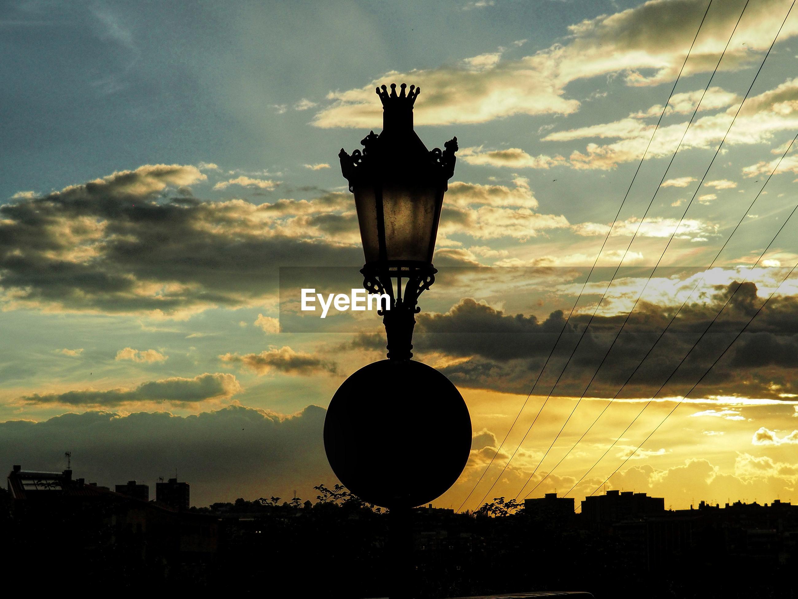 SILHOUETTE LAMP AGAINST SKY