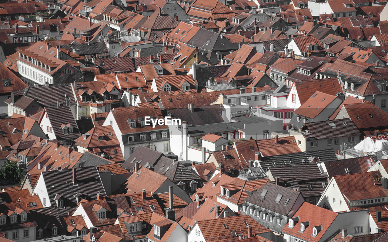 architecture, building exterior, built structure, roof, building, residential district, house, city, crowd, crowded, full frame, high angle view, day, backgrounds, outdoors, town, community, nature, environment, townscape, roof tile, chaos