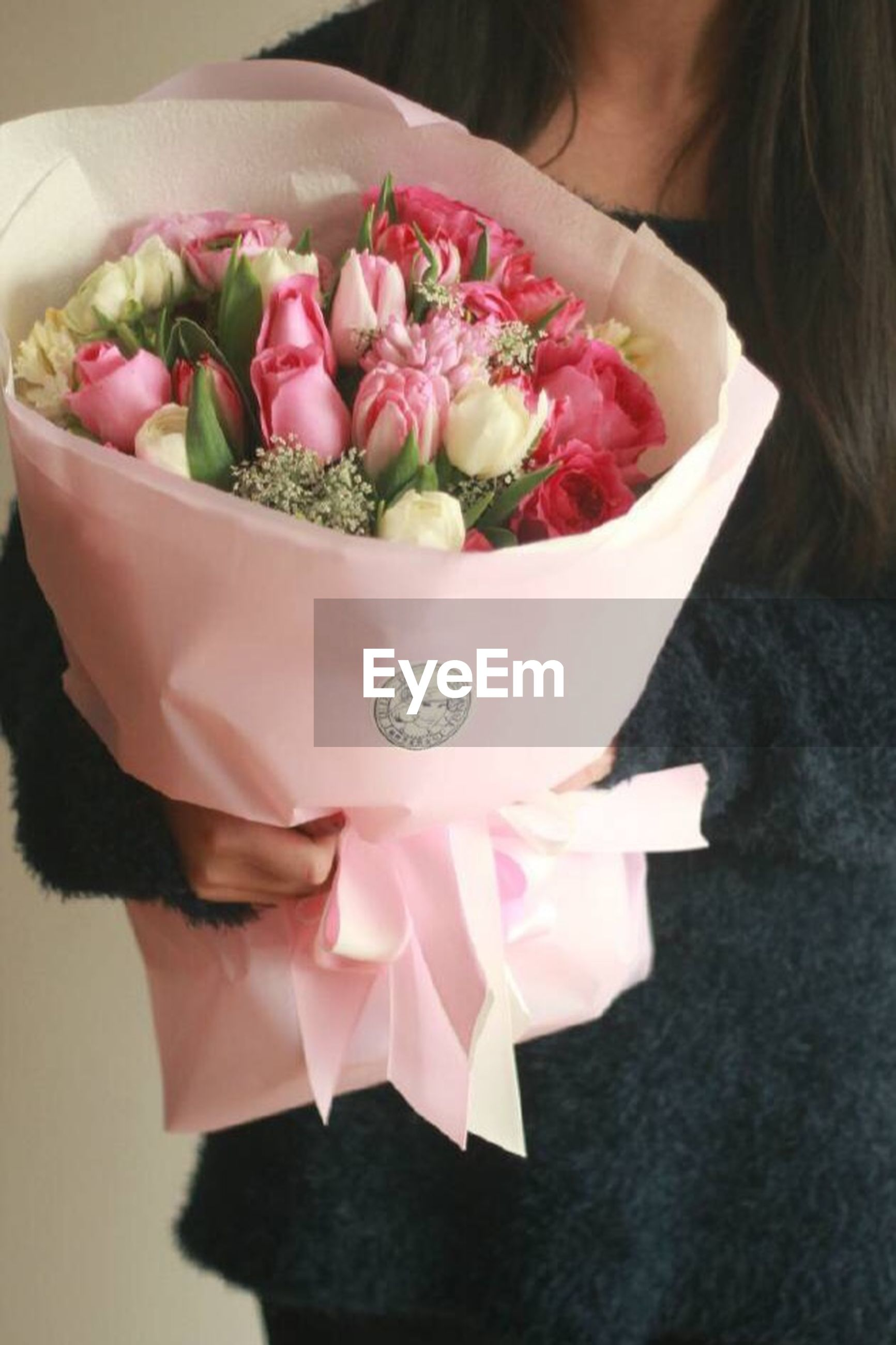 indoors, flower, freshness, holding, person, lifestyles, leisure activity, table, bouquet, food and drink, high angle view, pink color, close-up, decoration, wedding, celebration
