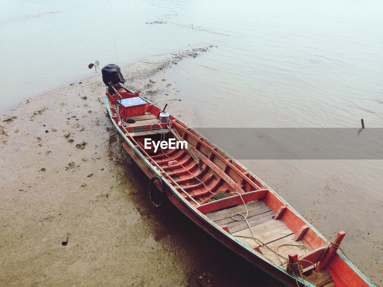 water, nautical vessel, transportation, high angle view, day, mode of transportation, nature, sea, beach, tranquility, outdoors, beauty in nature, land, moored, one person, tranquil scene, rowboat