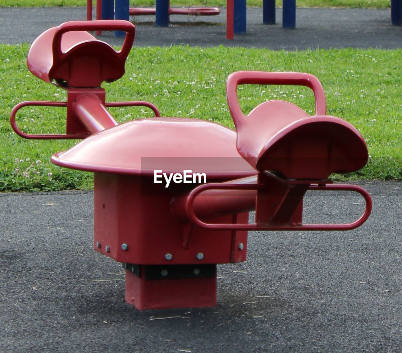 day, red, no people, empty, metal, nature, grass, green color, absence, outdoors, playground, plastic, park, plant, sunlight, seat, mailbox, park - man made space, pink color, outdoor play equipment