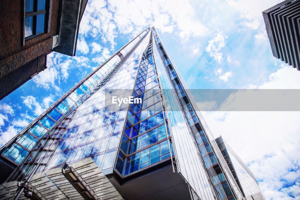 architecture, building exterior, cloud - sky, sky, low angle view, built structure, skyscraper, window, modern, city, day, outdoors, no people
