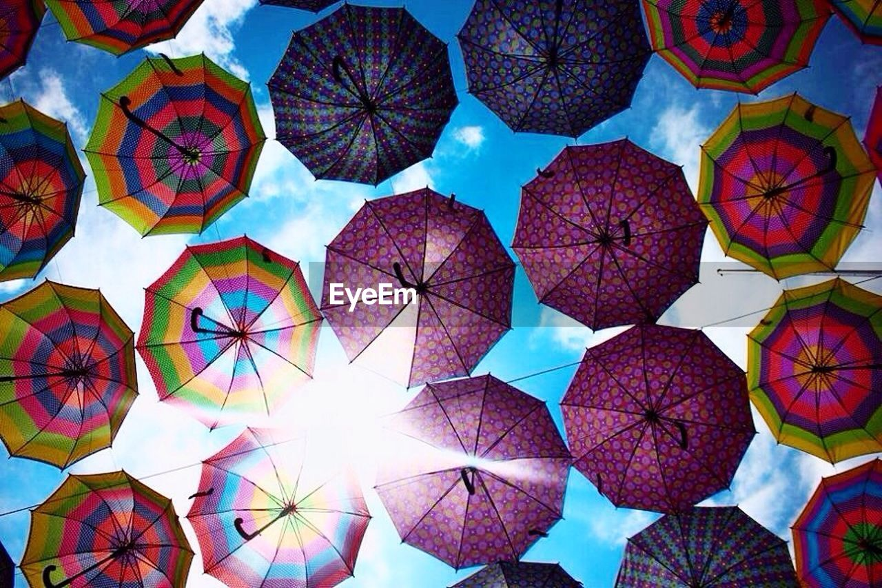 multi colored, no people, umbrella, large group of objects, pattern, full frame, day, creativity, art and craft, design, hanging, low angle view, still life, protection, outdoors, shape, variation, backgrounds, decoration, directly below, floral pattern