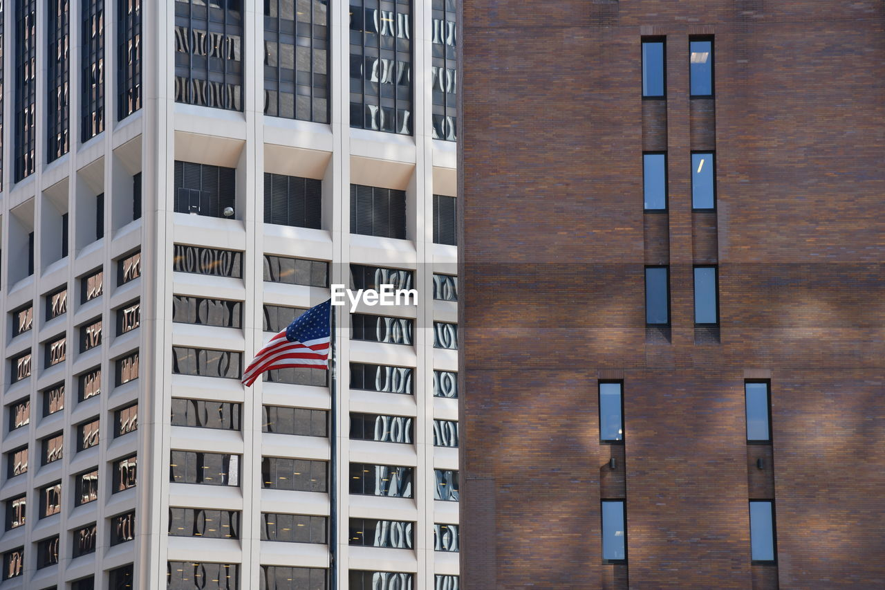 building exterior, architecture, built structure, city, patriotism, building, flag, striped, people, freedom, window, outdoors, pride, office building exterior, day, office, independence, skyscraper, national icon