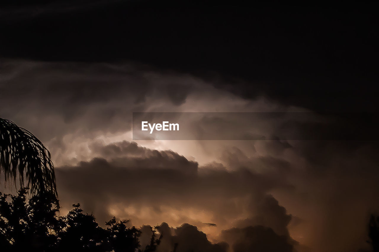 cloud - sky, beauty in nature, sky, nature, scenics, no people, silhouette, tranquility, sunset, tranquil scene, outdoors, tree, low angle view, storm cloud, night