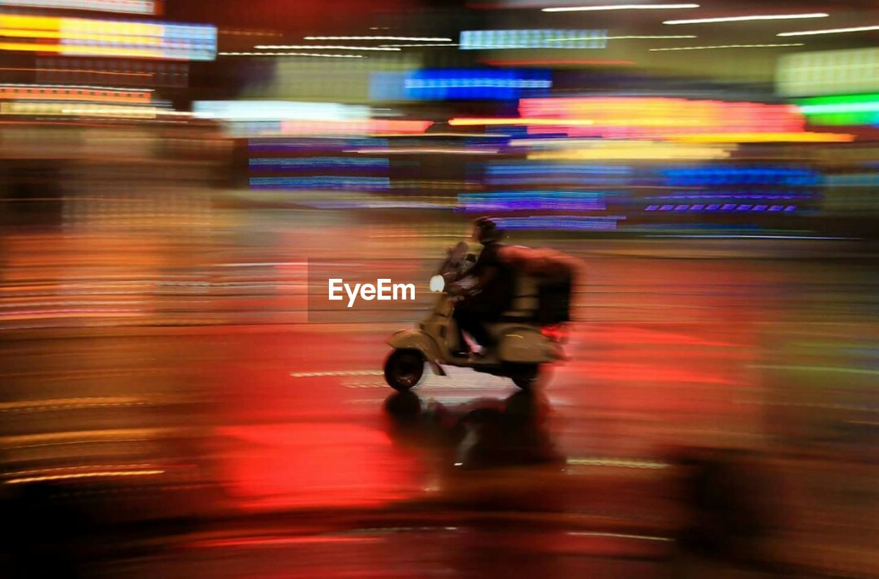 blurred motion, motion, speed, transportation, real people, night, men, street, illuminated, lifestyles, long exposure, city, outdoors, leisure activity, full length, one person, adult, people