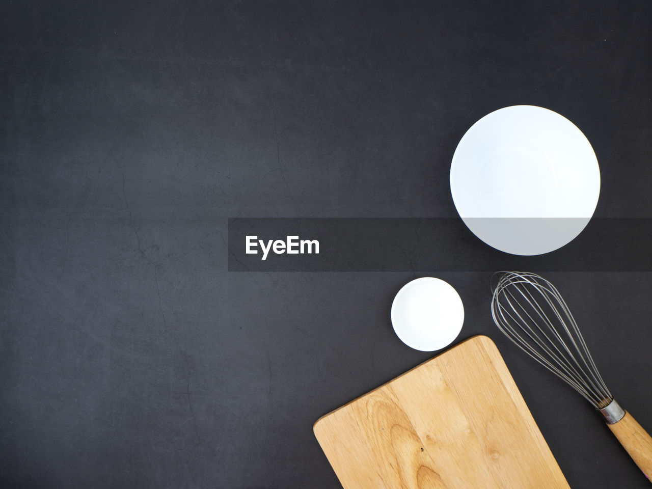 indoors, kitchen utensil, no people, table, wood - material, still life, eating utensil, close-up, food, copy space, food and drink, cutting board, high angle view, fork, geometric shape, directly above, studio shot, circle, white color, household equipment, black background