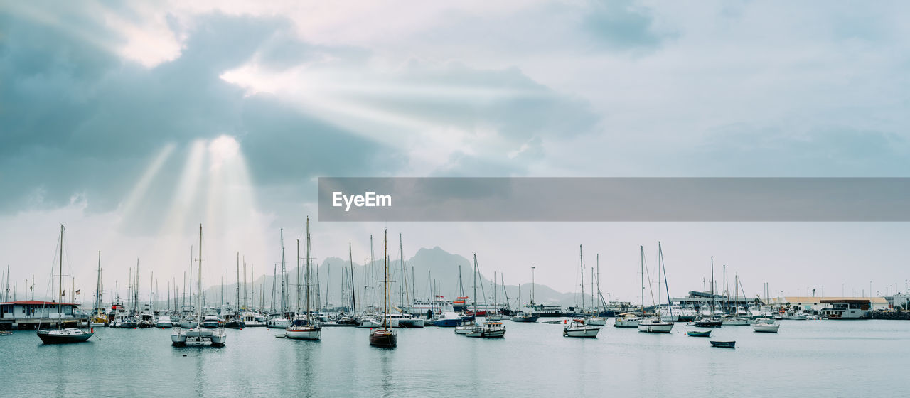 transportation, sky, nautical vessel, water, cloud - sky, mode of transportation, sailboat, harbor, mast, sea, nature, pole, moored, waterfront, no people, day, commercial dock, sunlight, pier, outdoors, yacht, marina