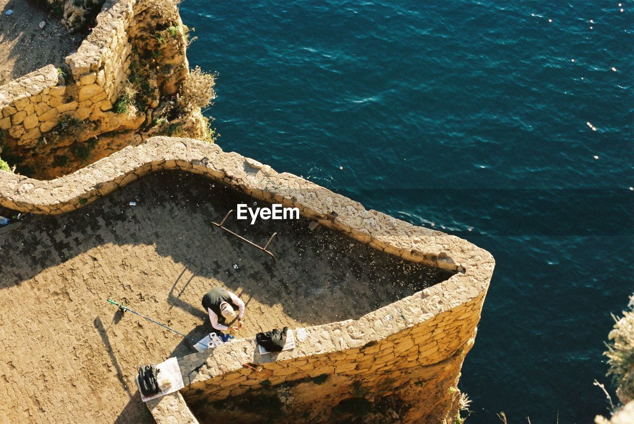 High Angle View Of A Man By The Sea