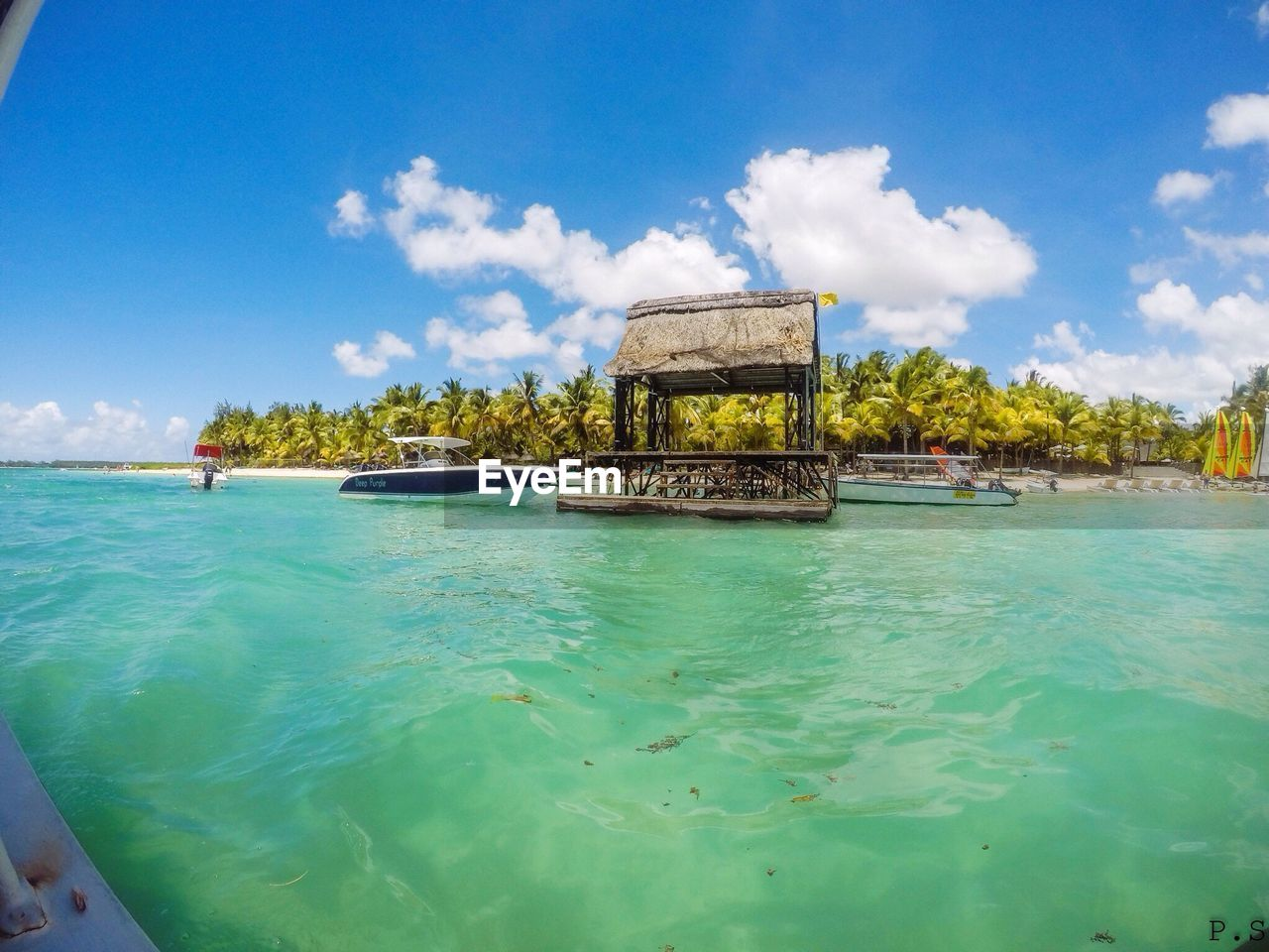 sea, sky, cloud - sky, water, day, beauty in nature, nature, scenics, outdoors, blue, tranquility, travel destinations, vacations, tree, beach, built structure, no people, architecture, horizon over water
