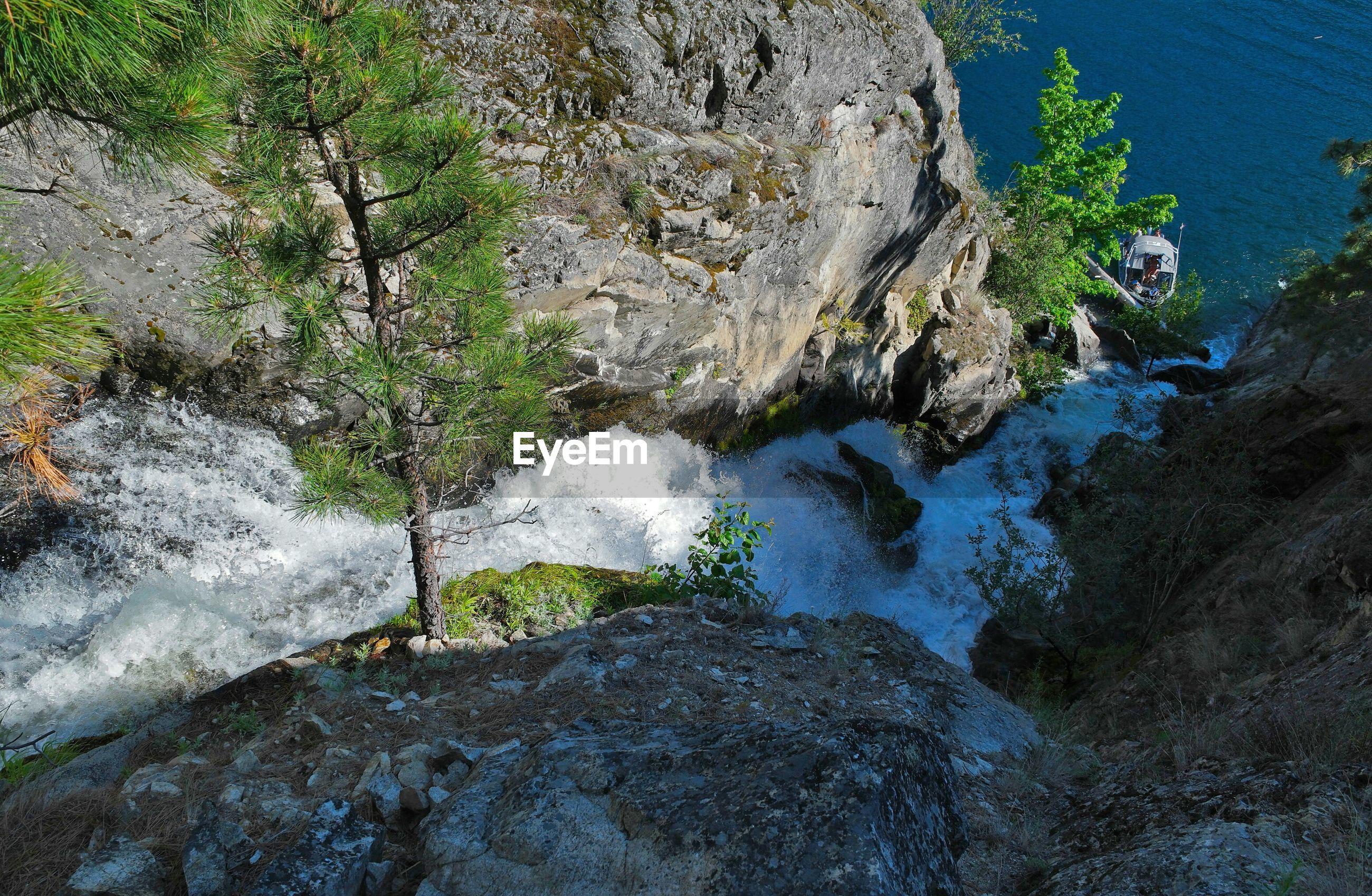 Waterfall emptying into lake chelan