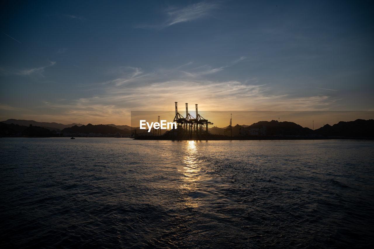 SILHOUETTE OF SHIP IN SEA