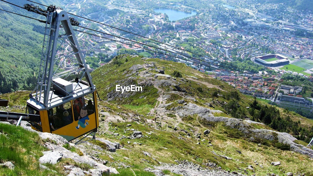 cable car, transportation, overhead cable car, mode of transportation, day, mountain, nature, no people, connection, architecture, plant, beauty in nature, high angle view, built structure, outdoors, scenics - nature, cable, land, tree, landscape