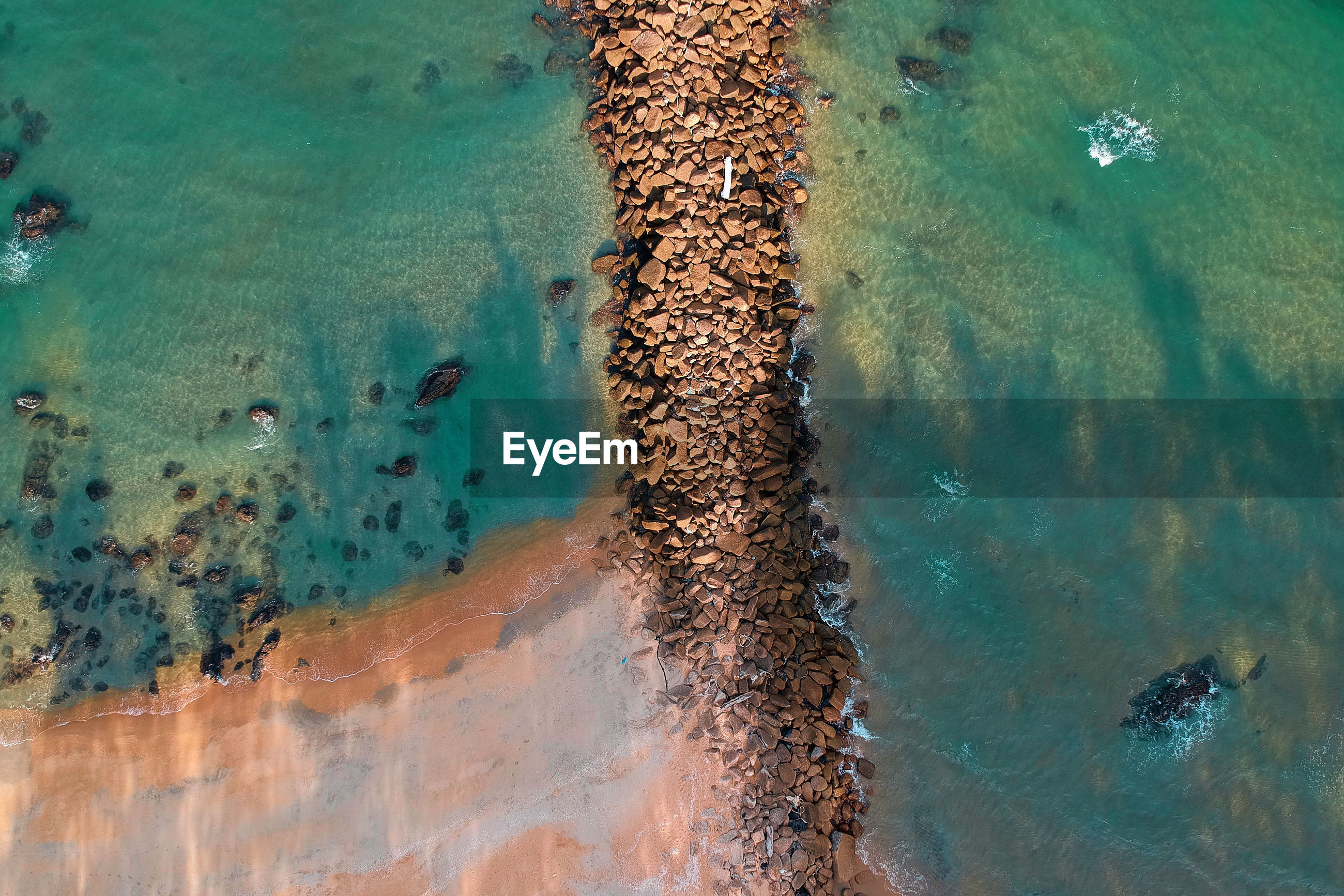 HIGH ANGLE VIEW OF SEA WATER ON LAND