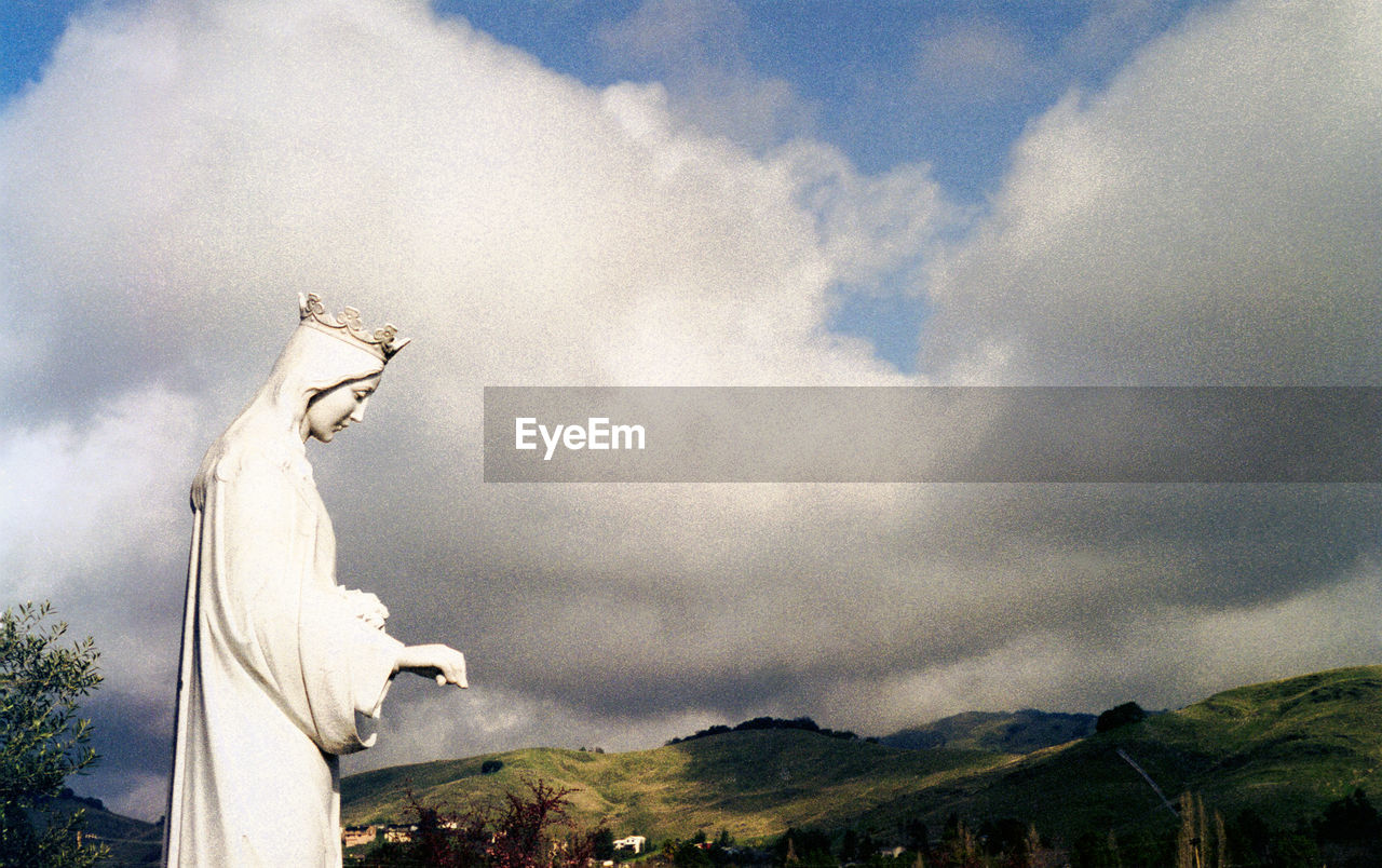 cloud - sky, sky, statue, sculpture, mountain, day, nature, representation, art and craft, human representation, spirituality, religion, belief, no people, creativity, place of worship, architecture, outdoors, angel