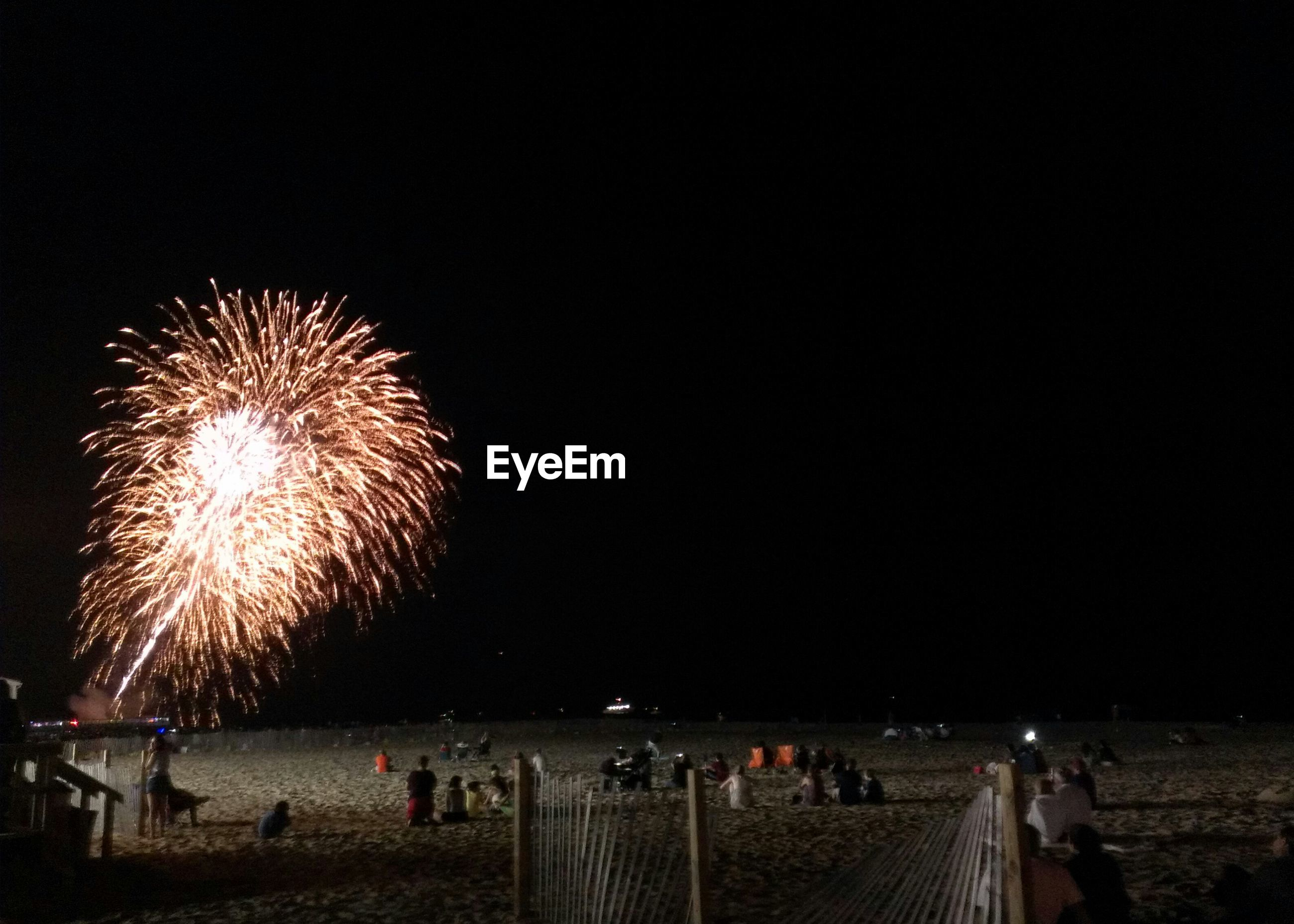 Fire crackers on beach at night