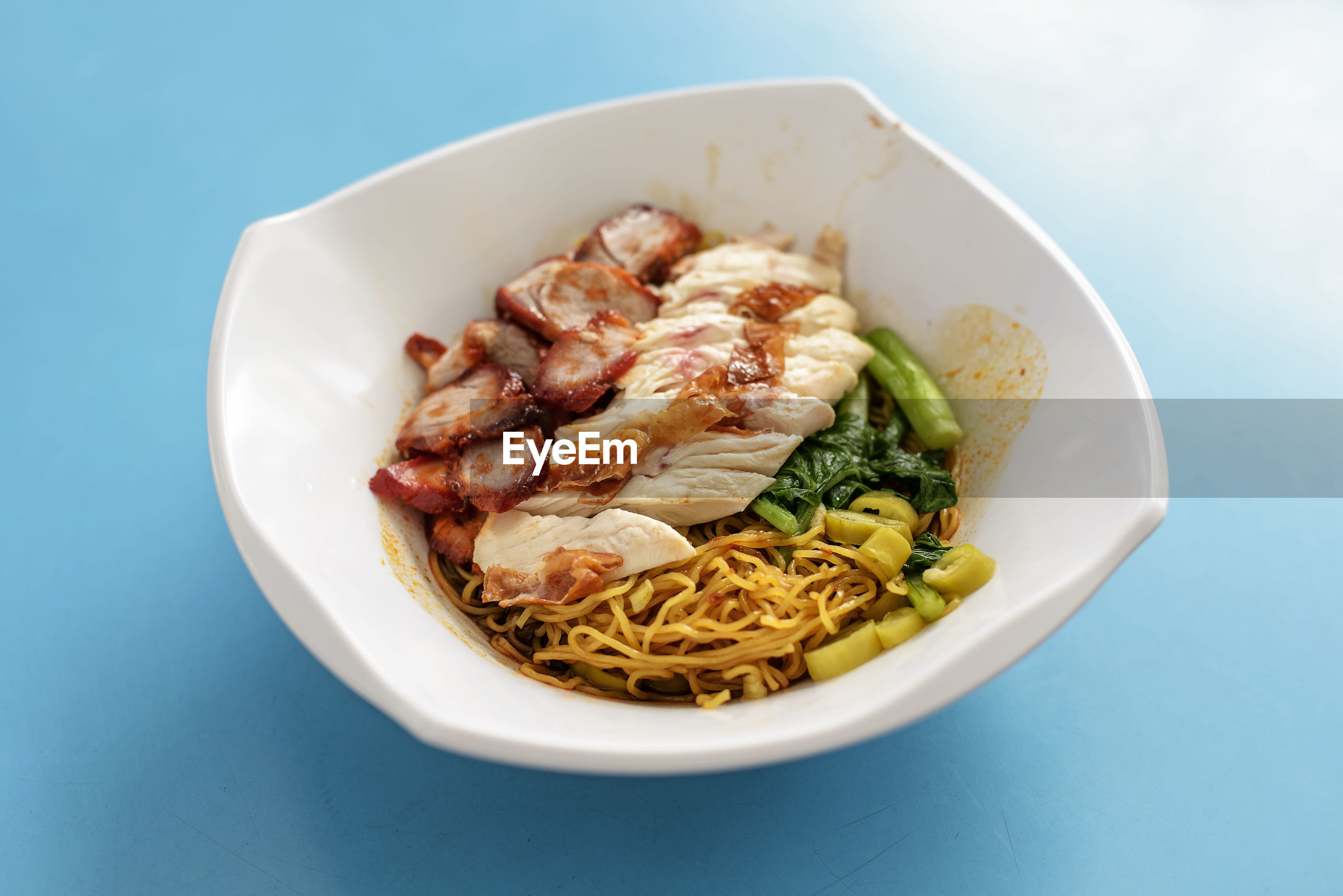 High angle view of food in bowl over blue background