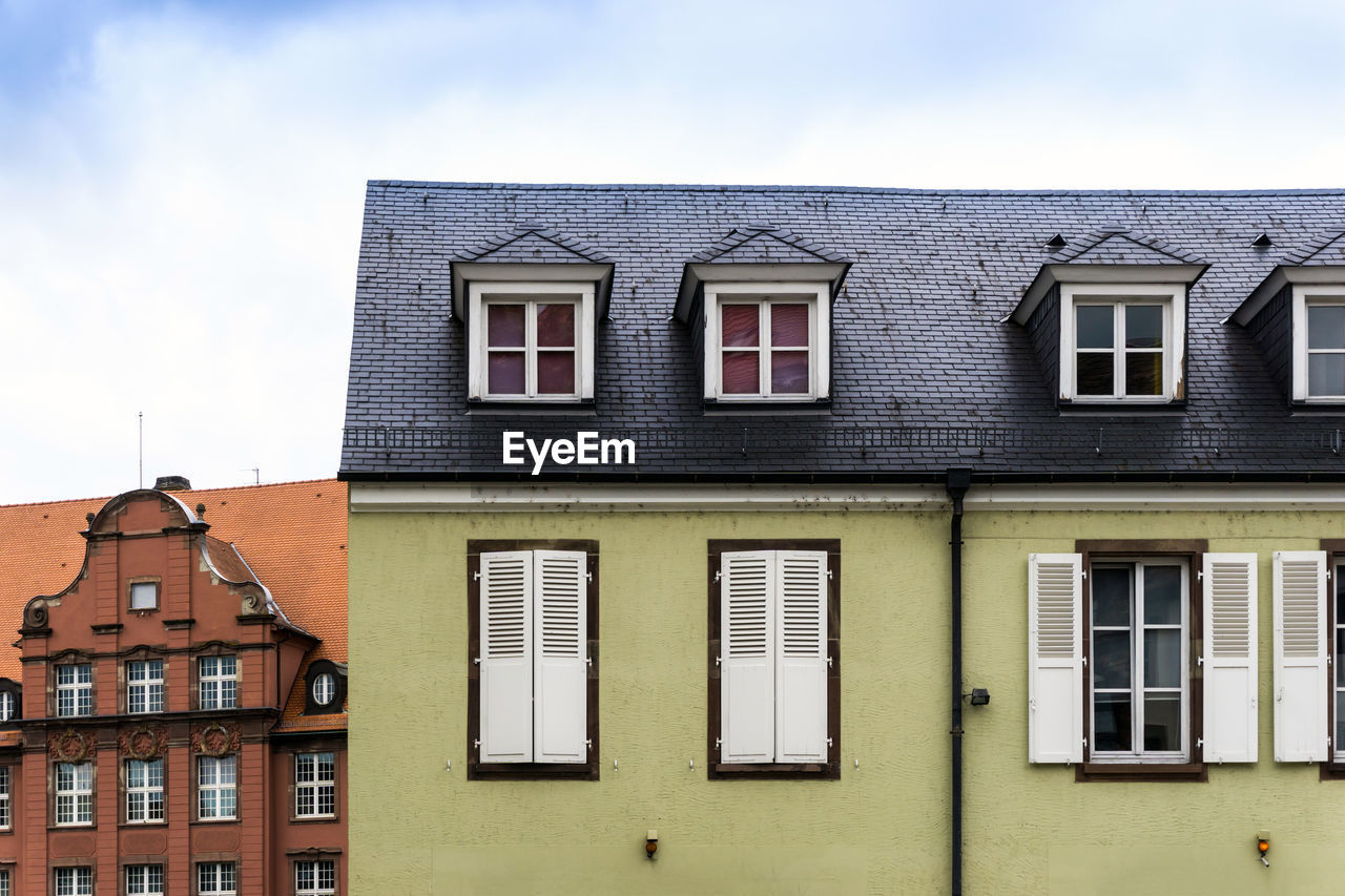 window, architecture, built structure, building exterior, building, residential district, day, no people, low angle view, sky, outdoors, in a row, side by side, house, nature, roof, city, glass - material, cloud - sky, sunlight, row house, apartment