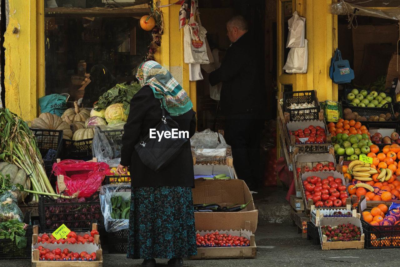 Women Standing Fruit Stall