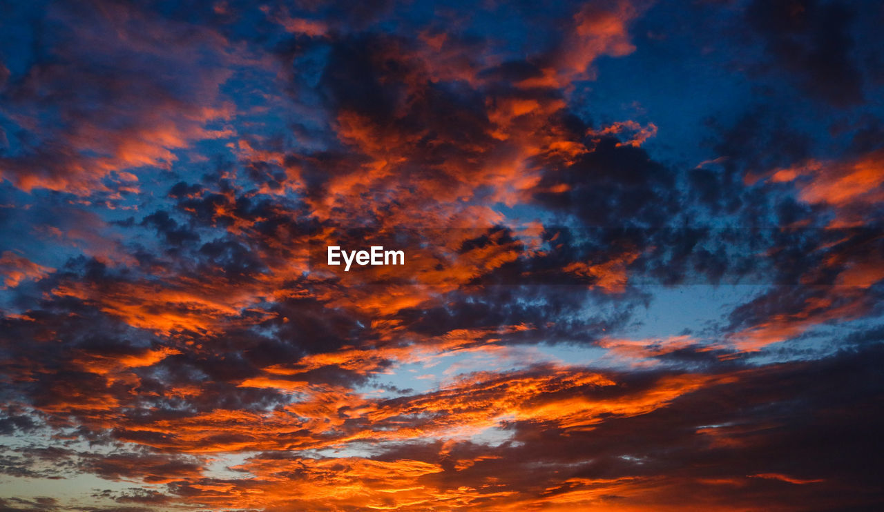 sky, beauty in nature, cloud - sky, sunset, orange color, scenics - nature, low angle view, tranquility, tranquil scene, no people, nature, backgrounds, dramatic sky, idyllic, full frame, outdoors, cloudscape, moody sky, blue, meteorology, romantic sky