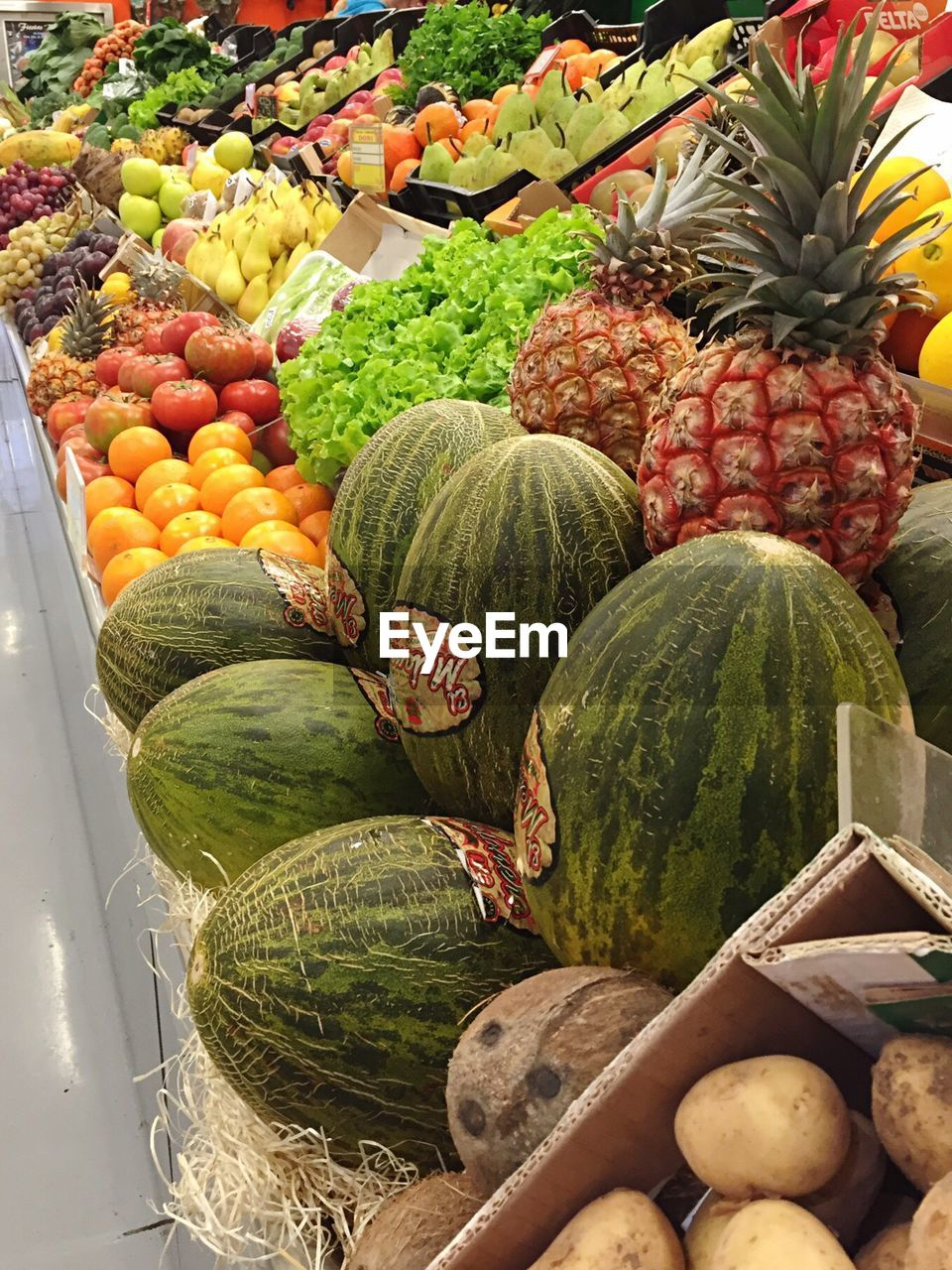 Various fruits displayed in shop for sale