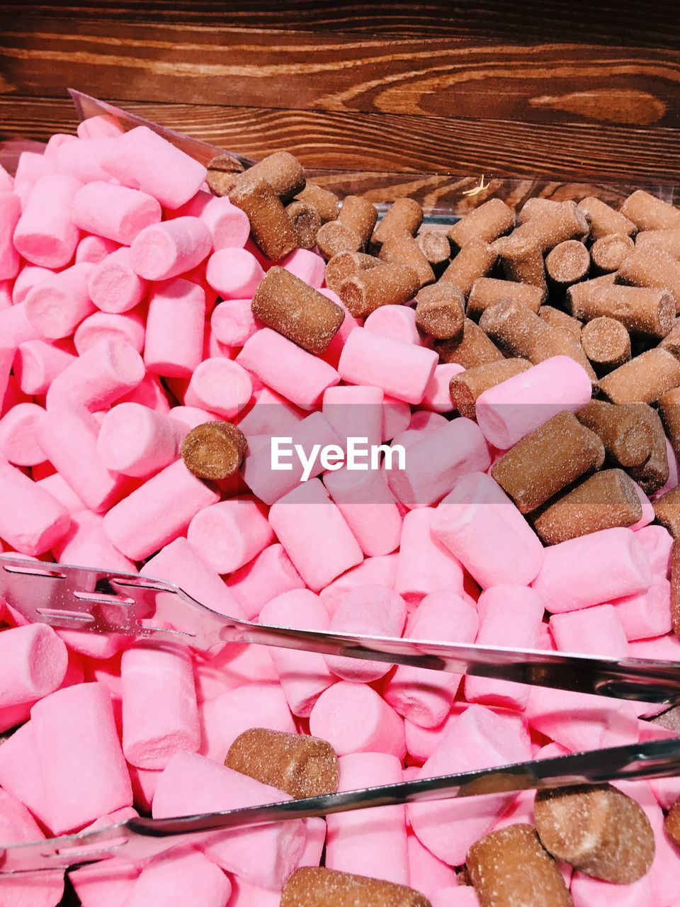 pink color, large group of objects, sweet food, food, sweet, food and drink, still life, indulgence, indoors, no people, freshness, candy, unhealthy eating, choice, heart shape, variation, temptation, abundance, baked, high angle view, positive emotion, snack