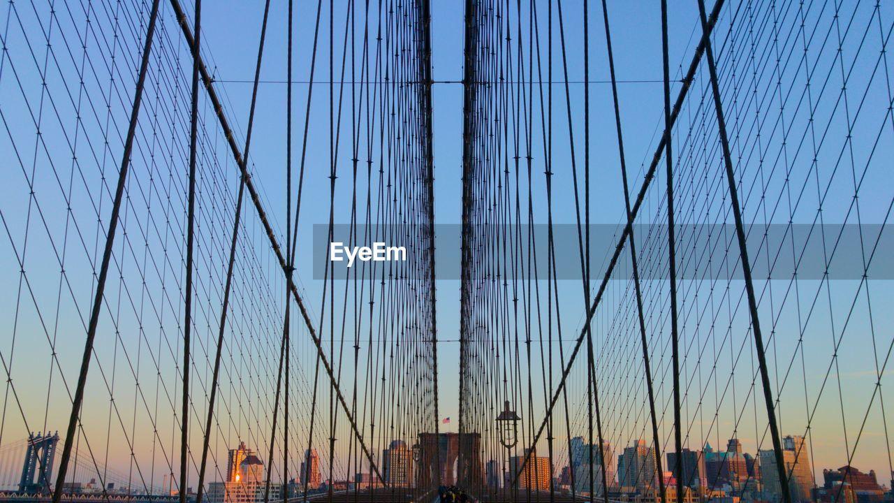 Brooklyn bridge against sky during sunset